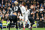 Real Madrid Alvaro Morata and Deportivo de la Coruña Raul Albentosa, Guilherme Dos Santos during La Liga match between Real Madrid and Deportivo de la Coruña at Santiago Bernabeu Stadium in Madrid, Spain. December 10, 2016. (ALTERPHOTOS/BorjaB.Hojas)