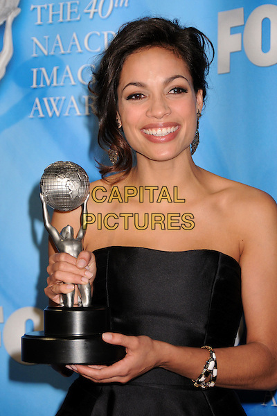 ROSARIO DAWSON.40th Annual NAACP Image Awards - Press Room at the Shrine Auditorium, Los Angeles, California, USA..February 12th, 2009.half length award trophy black strapless dress silk satin earrings dangling bracelet .CAP/ADM/BP.©Byron Purvis/AdMedia/Capital Pictures.