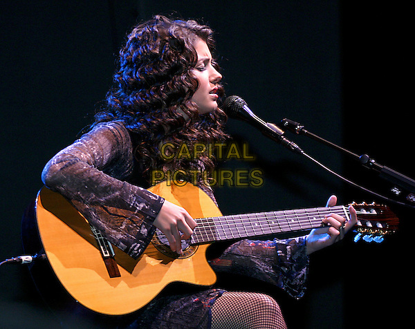 KATIE MELUA.Performs live in concert at the NIA in Birmingham, .18th October 2004..half length on stage gig music guitar.Ref: SR.www.capitalpictures.com.©Stephen Rose/Capital Pictures.