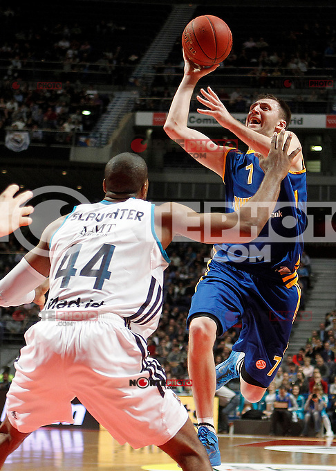 Real Madrid's Marcus Slaughter (l) and BC Khimki MR's Vitaly Fridzon during Euroleague 2012/2013 match.November 23,2012. (ALTERPHOTOS/Acero) /NortePhoto