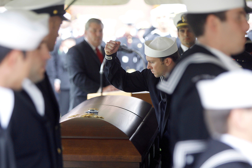 TOMS RIVER, N.J. -- A Navy SEAL pounds his Special Warfare insignia, also known as a SEAL Trident, into the lid of the casket containing the remains of his fallen comrade during a funeral at Ocean County Memorial Park. Dennis C. Miranda, 24, a Navy Seal from Toms River was killed in a helicopter crash in southern Afghanistan last week.  (9/30/2010)  photo by Andrew Mills/The Star-Ledger.. Sent DIRECT TO SELECTS Thursday, September 30, 2010 15:02:12 4896 3264