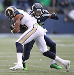 Seattle Seahawks defensive back DeShawn Shead wraps up St. Louis Rams wide receiver Kenny Britt (18) at CenturyLink Field in Seattle, Washington on December 27, 2015.  The Rams beat the Seahawks 23-17.      ©2015. Jim Bryant Photo. All Rights Reserved