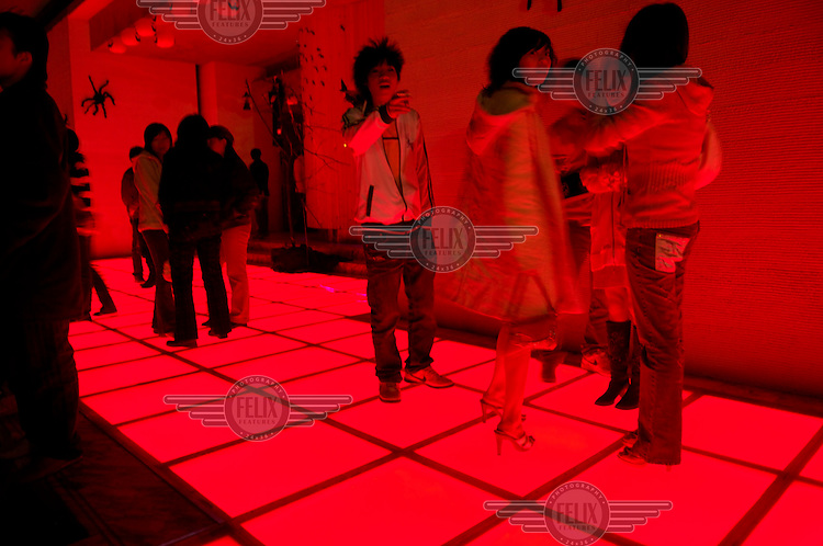 Youths at the entry to a Beijing nightclub.