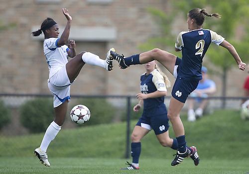 September 01, 2013:  UCLA forward Taylor Smith (14) and Notre Dame midfielder Mandy Laddish (2) battle for the ball during NCAA Soccer match between the Notre Dame Fighting Irish and the UCLA Bruins at Alumni Stadium in South Bend, Indiana.  UCLA defeated Notre Dame 1-0.