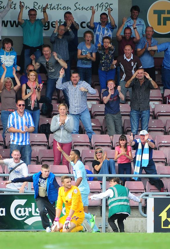 Preston North End's Declan Rudd looks dejected as Coventry City's Callum Wilson celebrates scoring his sides third goal <br /> <br /> Photo by Chris Vaughan/CameraSport<br /> <br /> Football - The Football League Sky Bet League 1 - Coventry City v Preston North End - Sunday 25th August 2013 - Sixfields Stadium - Northampton<br /> <br /> &copy; CameraSport - 43 Linden Ave. Countesthorpe. Leicester. England. LE8 5PG - Tel: +44 (0) 116 277 4147 - admin@camerasport.com - www.camerasport.com