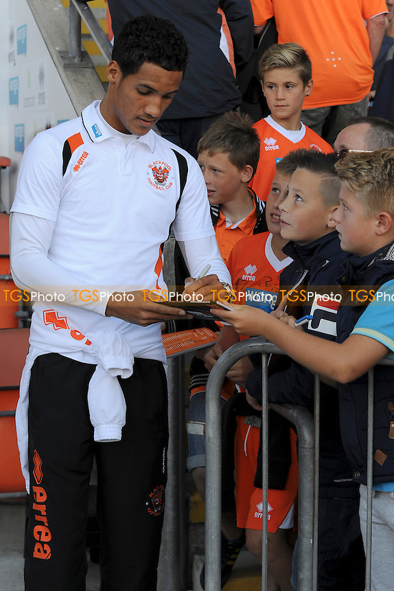 Thomas Ince of Blackpool signs autographs for fans - Blackpool vs Reading - Sky Bet Championship Football at Bloomfield Road, Blackpool, Lancashire - 24/08/13 - MANDATORY CREDIT: Greig Bertram/TGSPHOTO - Self billing applies where appropriate - 0845 094 6026 - contact@tgsphoto.co.uk - NO UNPAID USE