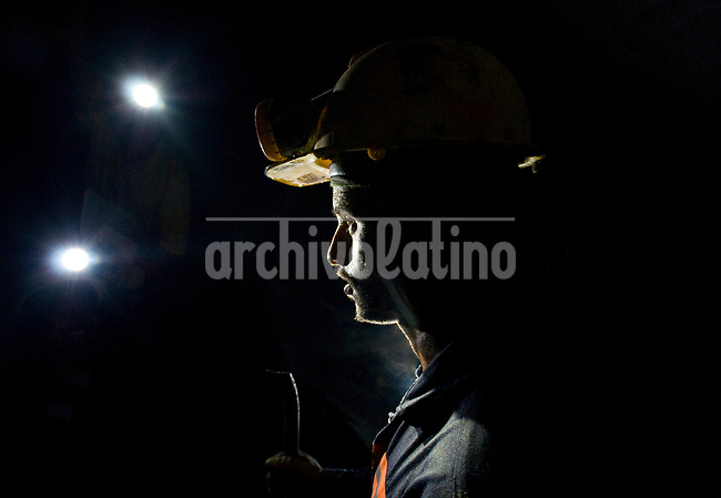 looking for gold in a gallery underground in Segovia, Antioquia, Colombia