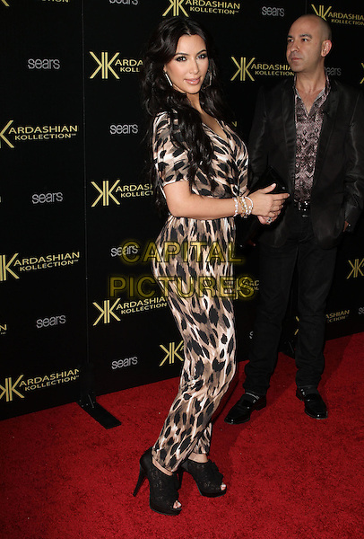 Kim Kardashian.The Launch Party for The Kardashian Kollection for Sears held at The Colony in Hollywood, California, USA..August 17th, 2011.full length black brown beige leopard print jumpsuit clutch bag open toe shoes ankle boots  side.CAP/ADM/KB.©Kevan Brooks/AdMedia/Capital Pictures.