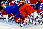 31 March 2010: Montreal Canadiens' goaltender Carey Price is smothered by players after making a second period save against the Carolina Hurricanes at the Bell Centre in Montreal, Quebec, Canada. The Hurricanes defeated the Canadiens 2-1 in their last meeting of the regular season. Mandatory Credit: Ed Wolfstein Photo