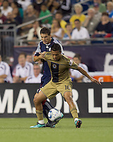 Philadelphia Union defender Michael Orozco Fiscal (16) shields ball from New England Revolution midfielder Marko Perovic (29). The Philadelphia Union defeated New England Revolution, 2-1, at Gillette Stadium on August 28, 2010.