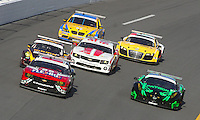 A pack of GT cars in action during the Rolex 24 at Daytona, Daytona International Speedway, Daytona Beach, FL, January 2011.  (Photo by Brian Cleary/www.bcpix.com)