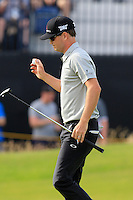 Zach Johnson (USA) sinks his birdie putt on the 14th green during Thursday's Round 1 of the 145th Open Championship held at Royal Troon Golf Club, Troon, Ayreshire, Scotland. 14th July 2016.<br /> Picture: Eoin Clarke | Golffile<br /> <br /> <br /> All photos usage must carry mandatory copyright credit (&copy; Golffile | Eoin Clarke)