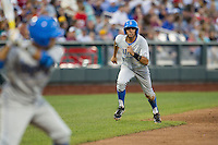 UCLA outfielder Brian Carroll (24) takes his lead off of third base against the North Carolina State Wolfpack during Game 8 of the 2013 Men's College World Series on June 18, 2013 at TD Ameritrade Park in Omaha, Nebraska. The Bruins defeated the Wolfpack 2-1, eliminating North Carolina State from the tournament. (Andrew Woolley/Four Seam Images)