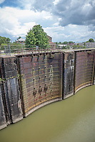 Plaquemine Lock State Historic Site, located in Plaquemine, Louisiana, commemorates an early example of hydraulic engineering design and the historic significance of Bayou Plaquemine, an important navigable waterway that was once a distributary of the Mississippi River. Bayou Plaquemine promoted settlement beginning in the 18th century and helped the area economically by providing an access route between southwestern Louisiana (and thus Texas) and the Mississippi via the Atchafalaya Basin.<br /> <br /> The lock itself was designed by Colonel George Washington Goethals of the United States Army Corps of Engineers, who later served as chief engineer of the construction of the Panama Canal Lock, and went on to be the Canal Zone's first governor. Plaquemine Lock was opened on April 9, 1909 after 14 years of construction. When it was built, Plaquemine Lock was the highest freshwater lift of any lock in the world. The lock initially utilized a gravity-flow principle until pumps were installed years later.<br /> <br /> The lock was closed after 52 years of service in 1961 due to increased river traffic and the demand for a larger lock, which opened thereafter in Port Allen. The Plaquemine Lock structure was placed on the National Register of Historic Places in 1972. Today, the Gary James Hebert Memorial Lockhouse serves as an on-site museum and visitors center. It is named for the man who led the way to help preserve the Lock site, which today covers 19 acres.