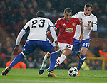 Henrikh Mkhitaryan of Manchester United (C) is tackled by Eder Alvarez Balanta of Basel (L) and Taulant Xhara of Basel during the Champions League Group A match at the Old Trafford Stadium, Manchester. Picture date: September 12th 2017. Picture credit should read: Andrew Yates/Sportimage