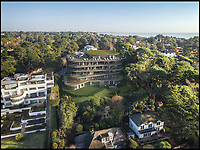 BNPS.co.uk (01202 558833)<br /> Pic: FJB/BNPS<br /> <br /> Harbour Height Hotel is to be transformed into a smaller hotel with apartments.<br /> <br /> Plans to transform the millionaire's resort of Sandbanks into 'Britain's Miami Beach' with two new superhotel's and apartments as part of a &pound;250m development have been unveiled. <br /> <br /> A pair of century-old hotels on the exclusive Dorset peninsula will be bulldozed to make way for an extravagant five star hotel on the beach and a smaller hotel with apartments on the cliffs above.<br /> <br /> The luxurious 175 room establishment will replace the existing Sandbanks Hotel, a former Victorian seaside villa built in the 1880s that is now 'coming to the end of its economic life cycle.'<br /> <br /> In keeping with the Miami Beach look, the super hotel will be Art-Deco in style, have curved floors and painted white with palm trees in the grounds.<br /> <br /> The existing historic Harbour Heights Hotel will also be demolished to make way for the second part of the radical development.