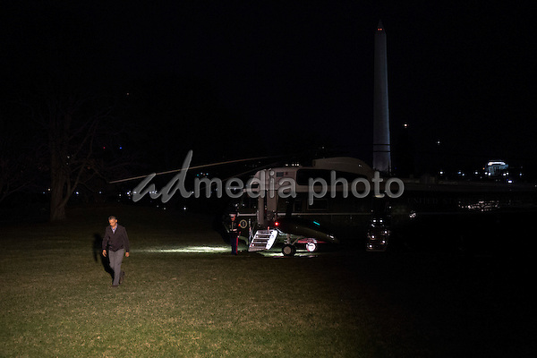 United States President Barack Obama waves as he exits Marine One on the South Lawn of the White House in Washington, D.C., U.S., on Saturday, March 12, 2016. The President returned from Texas, where he participated in a conversation at the South By Southwest (SXSW) Interactive Festival in Austin on Friday and attended Democratic National Committee fundraising events in Dallas on Saturday. Photo Credit: Drew Angerer/CNP/AdMedia
