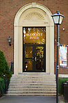 Garden City, New York, U.S. - August 29, 2014 - Adelphi University campus Blodgett Hall front entrance glass doorway and brick facade, in summer