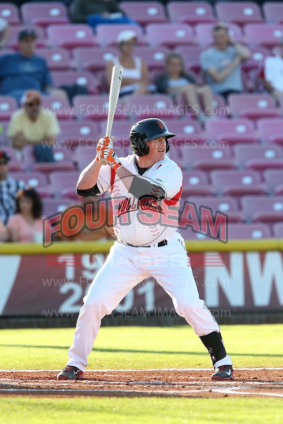 Skyler Ewing #44 of the Salem-Keizer Volcanoes bats against the Spokane Indians at Volcanoes Stadium on July 26, 2014 in Keizer, Oregon. Spokane defeated Salem-Keizer, 4-1. (Larry Goren/Four Seam Images)