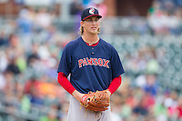 Henry Owens (37) of the Pawtucket Red Sox checks the runner at first during the game against the Charlotte Knights at BB&T Ballpark on August 10, 2014 in Charlotte, North Carolina.  The Red Sox defeated the Knights  6-4.  (Brian Westerholt/Four Seam Images)