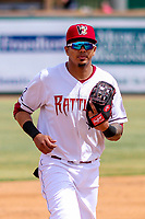 Wisconsin Timber Rattlers shortstop Gilbert Lara (11) jogs to the dugout between innings during a Midwest League game against the Clinton LumberKings on April 26, 2018 at Fox Cities Stadium in Appleton, Wisconsin. Clinton defeated Wisconsin 7-3. (Brad Krause/Four Seam Images)
