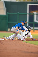 Northwest Arkansas Naturals outfielder Nick Heath (2) safely slides into second ahead of the tag attempt from Tulsa Drillers infielder Gavin Lux (10) on May 13, 2019, at Arvest Ballpark in Springdale, Arkansas. (Jason Ivester/Four Seam Images)