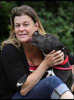 BNPS.co.uk (01202 558833)<br /> Pic: RichardCrease/BNPS<br /> <br /> ***Use Full Byline***<br /> <br /> Sharon Collings reunited with her Staffordshire Bull Terrier dog Ellie after five years<br /> <br /> A pet dog that was stolen five years ago has been reunited with its owner - after being found more than 500 miles away in Scotland.<br /> <br /> Sharon Collins, 36, popped into a newsagents in January 2009 and left her Staffordshire bull terrier, Ellie, tied up outside.<br /> <br /> When she returned two minutes later the black dog had gone.<br /> <br /> A dog-napper is thought to have unclipped Ellie's lead and ran off with her outside the shop in Bere Regis, Dorset.