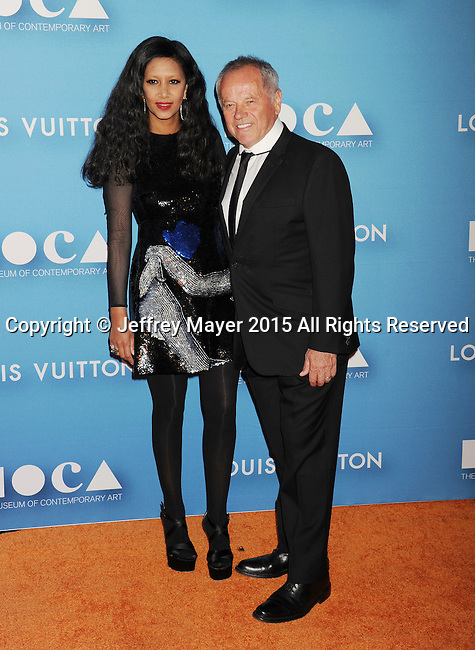 LOS ANGELES, CA - MAY 30: Chef Wolfgang Puck (R) and designer Gelila Assefa arrive at the 2015 MOCA Gala presented by Louis Vuitton at The Geffen Contemporary at MOCA on May 30, 2015 in Los Angeles, California.