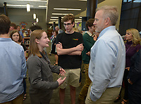 NWA Democrat-Gazette/ANDY SHUPE<br /> Fayetteville High School senior Cesca Craig (left) speaks Thursday, May 10, 2018, with Nate Magre (right), an advance placement history teacher, alongside her friend Ethan Favorite, a student at the University of Arkansas, during an academic signing ceremony in the Matthew Moore Library at the school. Craig plans to attend New York University and study anthropology.