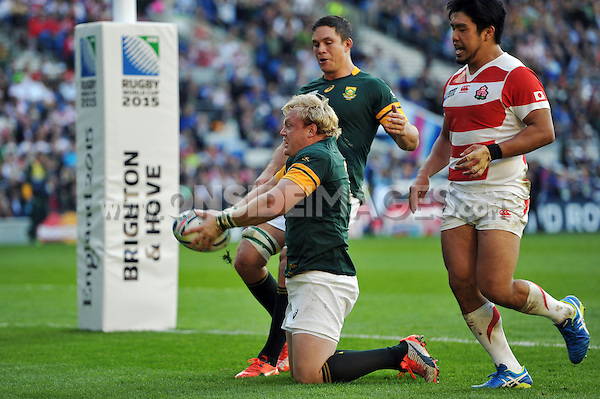 Adriaan Strauss of South Africa celebrates scoring a try. Rugby World Cup Pool B match between South Africa and Japan on September 19, 2015 at the Brighton Community Stadium in Brighton, England. Photo by: Patrick Khachfe / Onside Images