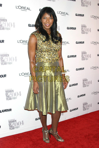 NATALIE COLE<br /> 15th Annual GLAMOUR Women of the Year Awards <br />  American Museum of Natural History<br /> New York City, New York, USA,<br /> 8th November 2004.<br /> full length green gold shiny silk satin skirt dress beaded top<br /> Ref: IW<br /> www.capitalpictures.com<br /> sales@capitalpictures.com<br /> &copy;Capital Pictures