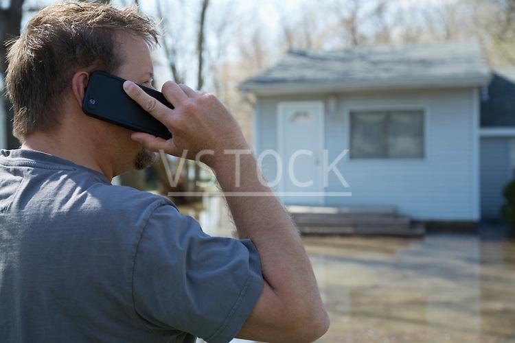 Man using smartphone during flood