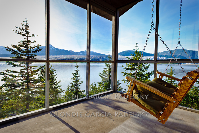 Cabin porch with a view of the Taku River, Southeastern, Alaska