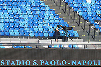A cameraman on the empty stands of the stadium prior to the Serie A football match between SSC  Napoli and SPAL at stadio San Paolo in Naples ( Italy ), June 28th, 2020. Play resumes behind closed doors following the outbreak of the coronavirus disease. <br /> Photo Cesare Purini / Insidefoto