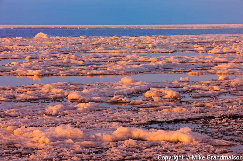 sunset over ice on Lake Manitoba<br /> Delta Marsh<br /> Manitoba<br /> Canada