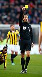 Nederland, Eindhoven, 25 november  2012.Eredivisie.Seizoen 2012-2013.PSV-Vitesse.Scheidsrechter Bas Nijhuis deelt een gele kaart uit.