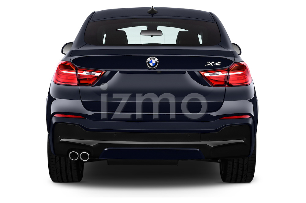 Straight rear view of a 2015 BMW X4 M sportpakket 5 Door SUV 2WD Rear View  stock images