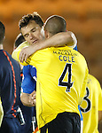 Lee McCulloch and Darren Cole embrace at full-time