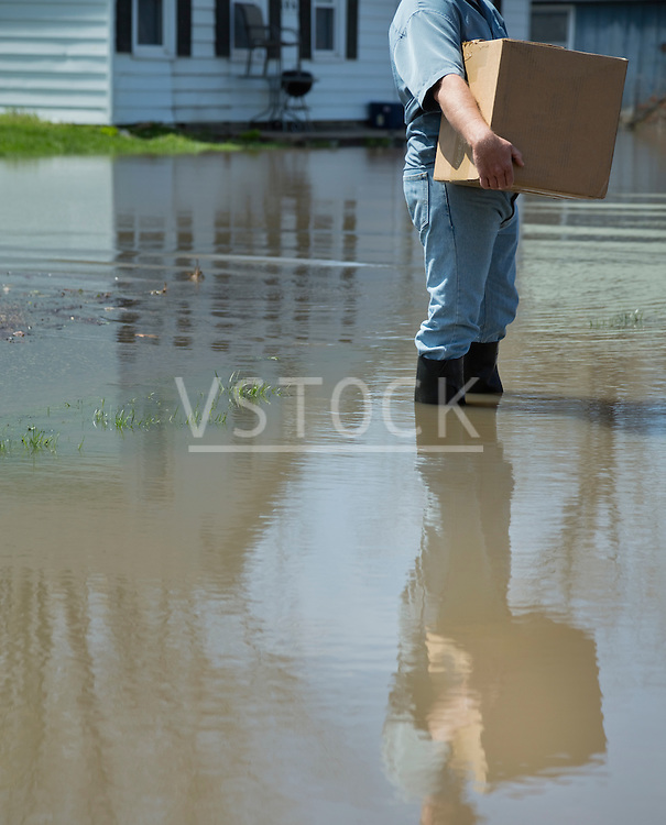 Man carrying package during flood