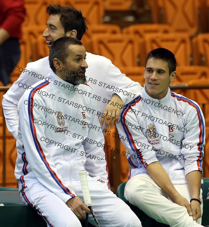 Davis Cup 2014 first round<br /> Serbia v Switzerland<br /> Team captain Bogdan Obradovic speaks with Djordje Djokovic (R) and Nikola Milojevic (C)<br /> Novi Sad, 02.02.2014.<br /> Foto: Srdjan Stevanovic/Starsportphoto.com&copy;