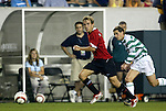 28 July 2004: Phil Neville (center) races away from Jackie McNamara (right) in the first half. Glasgow Celtic of the Scottish Premier League defeated Manchester United of the English Premier League 2-1 at Lincoln Financial Field in Philadelphia, PA in a ChampionsWorld Series friendly match..