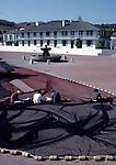 Fishermen working on nets in Custom House Plaza