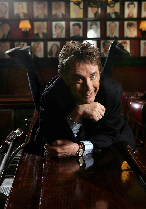 "(cover select)...MARTIN SHORT bellies up on the bar at Sardi's.  He is on Broadway in ""Martin Short: Fame Becomes Me"", a musical comedy spoof about celebrity, vanity and fame.  Sardi's, W. 44 St., NYC.  Newsday/ARI MINTZ  7/28/2006."