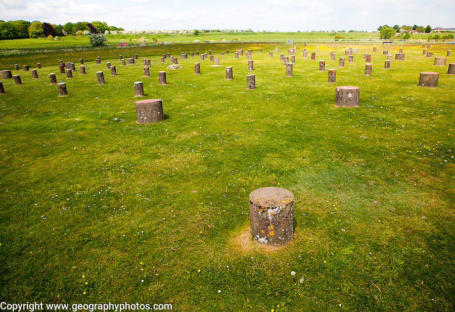 Concrete marker posts identify the position of wooden posts at Neolithic Woodhenge site at Amesbury, Wiltshire, England, UK