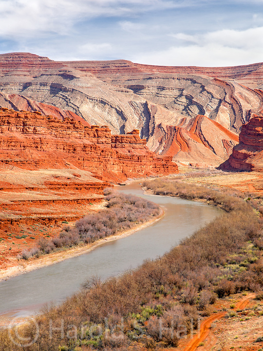 Near the small town of Mexican Hat, Utah the San Juan River winds through colorful red cliffs.