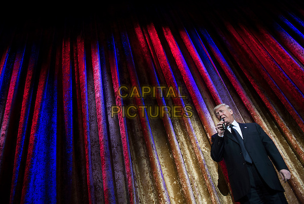 United States President-Elect Donald Trump delivers remarks at the Chairman's Global Dinner, at the Andrew W. Mellon Auditorium in Washington, D.C. on January 17, 2017. The invitation only black-tie event is a chance for Trump to introduce himself and members of his cabinet to foreign diplomats. <br /> Credit: Kevin Dietsch / Pool via CNP /MediaPunch<br /> CAP/MPI/RS<br /> &copy;RS/MPI/Capital Pictures