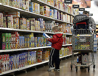 John Paul, right, and his John look for cereal while shopping at Wal-Mart Thursday, March 2, 2006, in Grove City, Ohio.<br />