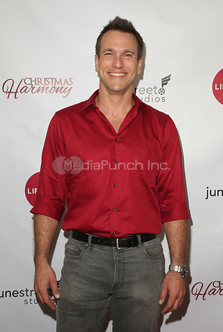 "LOS ANGELES, CA - NOVEMBER 7: Adam Mayfield, at Premiere of Lifetime's ""Christmas Harmony"" at Harmony Gold Theatre in Los Angeles, California on November 7, 2018. Credit: Faye Sadou/MediaPunch"