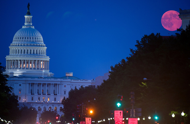 "UNITED STATES - JULY 12: The ""supermoon"" rises over the U.S. Capitol on Saturday night, July 12, 2014.  (Photo By Bill Clark/CQ Roll Call)"