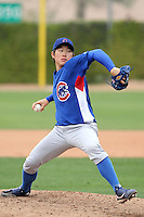 Jin-Young Kim of the Chicago Cubs pitches in an exhibition game against the Langley Blaze of the British Columbia Premier League at Fitch Park, the Cubs minor league complex, on March 21, 2011  in Mesa, Arizona. .Photo by:  Bill Mitchell/Four Seam Images.